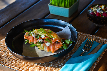 Croissant with smoked salmon for breakfast at luxury resort in Phan Thiet, Vietnam. Archivio Fotografico