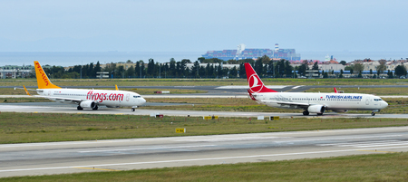 Istanbul, Turkey - Sep 30, 2018. Passenger airplanes taxiing on runway of Istanbul Ataturk Airport (IST).