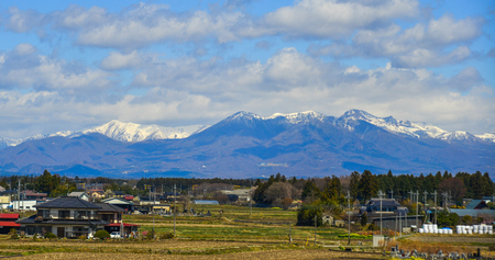 Fukushima, Japan - Apr 15, 2019. Small town with snow mountain in Fukushima, Japan. Fukushima is the place where the nuclear disaster occurred in 2011.