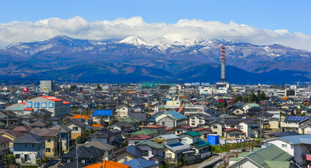 Fukushima, Japan - Apr 15, 2019. Cityscape with snow mountain in Fukushima, Japan. Fukushima is the place where the nuclear disaster occurred in 2011.