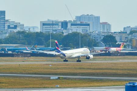 Saigon, Vietnam - Apr 17, 2018. Qatar Airways A7-AQA Airbus A350-900 (Latam Brasil) going to take-off from Tan Son Nhat Airport (SGN) in Saigon (Ho Chi Minh), Vietnam.
