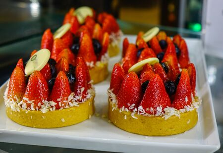 Sweet table (strawberry tarts) at luxury buffet restaurant. Food concept.
