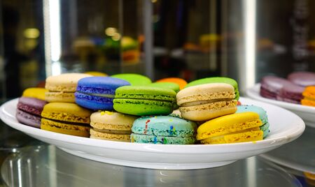 Sweet table (colorful macaron) at luxury buffet restaurant. Food concept.