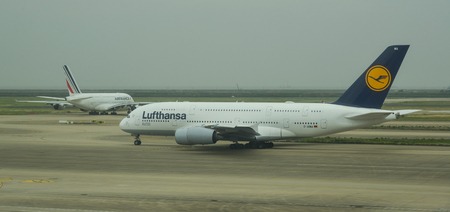Shanghai, China - Jun 6, 2019. Airbus A380 of Lufthansa and Air France taxiing on runway of Shanghai Pudong Airport (PVG).