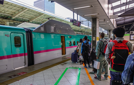 Tokyo, Japan - Apr 13, 2019. Passengers waiting for  train at  Station in Tokyo, Japan. High speed trains (bullet trains) called   operated by Japan Railways.