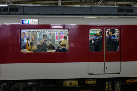 Osaka, Japan - Apr 18, 2019. Train stopping at railway station in Osaka, Japan. Trains are a very convenient way for visitors to travel around Japan.