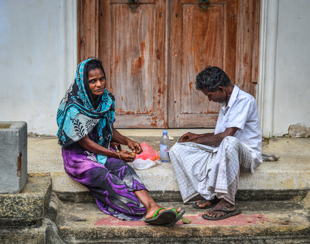 Galle, Sri Lanka - Dec 21, 2018. A couple sitting at rural house in Galle, Sri Lanka. Galle was the main port on the island in the 16th century. Editorial