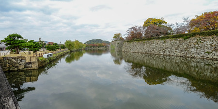 Moat of Himeji Castle in autumn. The castle is Japan unique architecture, built in the 17th century.