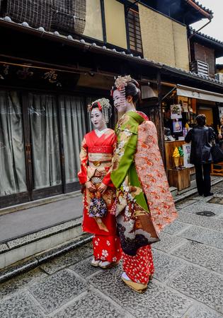 Kyoto, Japan - Nov 20, 2016. Japanese women wearing traditional dress (Kimono) on the historic street in downtown of Kyoto, Japan.