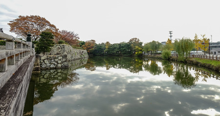 Himeji, Japan - Nov 17, 2016. Moat of Himeji Castle in autumn. The castle is Japan unique architecture, built in the 17th century. Editorial