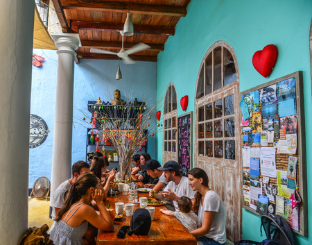 Galle, Sri Lanka - Dec 21, 2018. Tourists at vintage restaurant in Galle, Sri Lanka. Galle was the main port on the island in the 16th century.