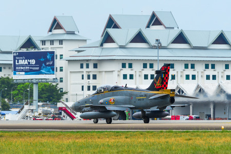 Langkawi, Malaysia - Mar 31, 2019. British Aerospace Hawk 200 of Royal Malaysian Air Force (TUDM M40-32) taxiing on runway of Langkawi Airport (LGK). 報道画像