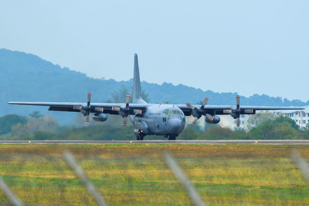 Langkawi, Malaysia - Mar 31, 2019. Lockheed C-130H Hercules Royal Malaysian Air Force (reg. TUDM M30-08) taxiing on runway of Langkawi Airport (LGK).