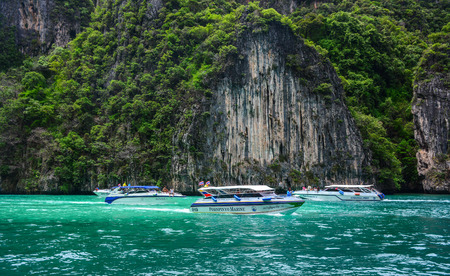 Phuket, Thailand - Jun 20, 2016. Speedboat on the sea in Phuket, Thailand. Phuket is 48 km in length, 21 km at its widest, on the west-facing Andaman Sea coastline.