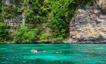 Phuket, Thailand - Jun 20, 2016. Tourist snorkeling in clear and shallow water of Phuket Island, Thailand. Phuket is on the west-facing Andaman Sea coastline.