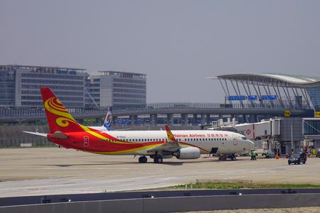 Shanghai, China - Jun 3, 2019. Hainan Airlines B-5522 (Boeing 737-800) taxiing on runway of Shanghai Pudong Airport (PVG).
