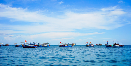 Quy Nhon, Vietnam - Oct 11, 2015. Wooden fishing boats docking on blue sea at sunny day in Quy Nhon, Vietnam.