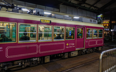Tokyo, Japan - Apr 17, 2019. Old style tram stopping at the station in Tokyo, Japan. Japanese railway industry has a long history, began in the late Edo period. Editöryel