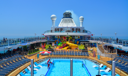 Shanghai, China - Jun 3, 2019. The central water park at cruise liner or ship Spectrum of the Seas by Royal Caribbean.
