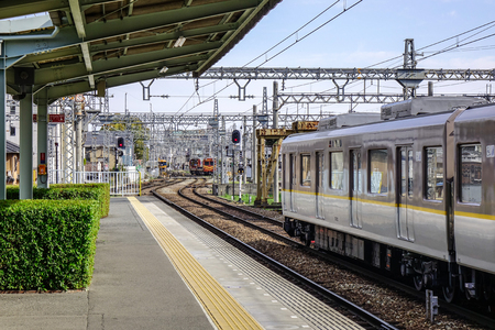 Osaka, Japan - Apr 12, 2019. A local train coming to the JR station in Osaka, Japan. Trains are a very convenient way for visitors to travel around Japan.