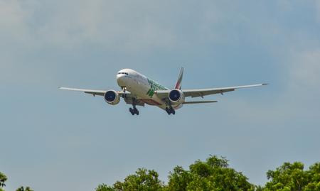 Singapore - Mar 26, 2019. Emirates A6-EPL (Boeing 777-300ER) landing at Changi Airport (SIN). Changi hits record 65 million passengers in 2018.
