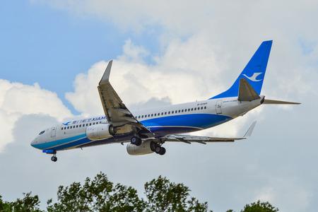 Singapore - Mar 26, 2019. Xiamen Airlines B-6489 (Boeing 737-800) landing at Changi Airport (SIN). Changi hits record 65 million passengers in 2018. Editorial