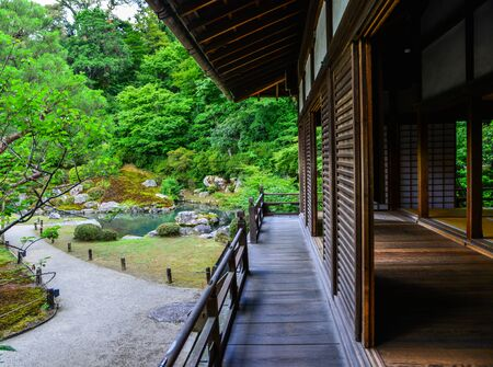 Ancient house with beautiful garden at summer day in Kyoto, Japan.