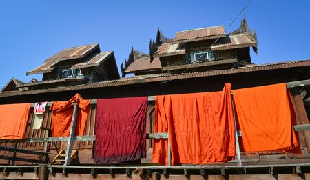 Drying robes at the wooden temple in Shan, Myanmar. 免版税图像