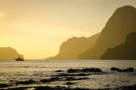 Seascape of the islands at sunset in El Nido, Palawan, Philippines.