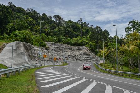 Langkawi, Malaysia - Apr 30, 2018. Rural road in Langkawi, Malaysia. Langkawi is an archipelago made up of 99 islands on Malaysia west coast.