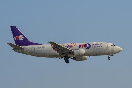 Saigon, Vietnam - Feb 8, 2019. A 737-300 airplane of YTO Cargo Airlines landing at Tan Son Nhat Airport (SGN) in Saigon (Ho Chi Minh City), Vietnam. Publikacyjne