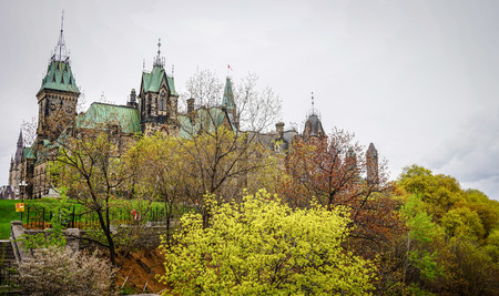 Ancient Parliament Buildings with autumn garden in Ottawa, Canada.