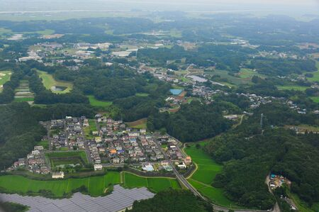 Flying over rural scenery at summer day near Narita, Japan.