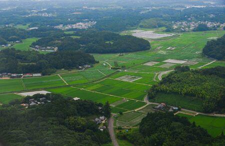 Flying over rural scenery at summer day near Narita, Japan.