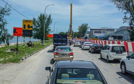 Penang, Malaysia - Aug 21, 2014. Traffic jam on the highway in Penang, Malaysia. Penang is the top destination within Malaysia for foreign investors.