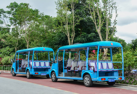 Nanning, China - Nov 1, 2015. Electric cart waiting for passengers in front of the botanic garden in Nanning, China.