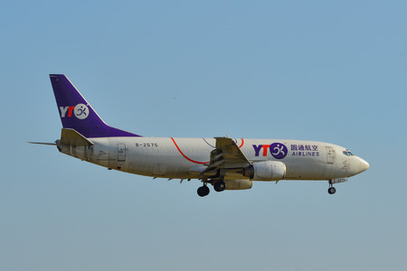 Saigon, Vietnam - Feb 16, 2019. A 737-300 airplane of YTO Cargo Airlines landing at Tan Son Nhat Airport (SGN) in Saigon (Ho Chi Minh City), Vietnam. Publikacyjne