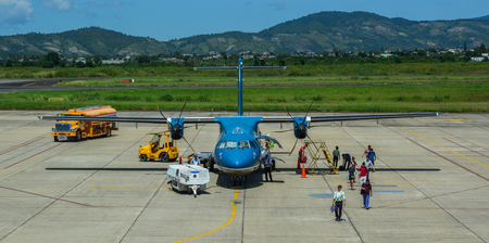 Dalat, Vietnam - Oct 30, 2015. An ATR 72 airplane of Vietnam Airlines docking at Lien Khuong Airport (DLI) in Dalat, Vietnam.