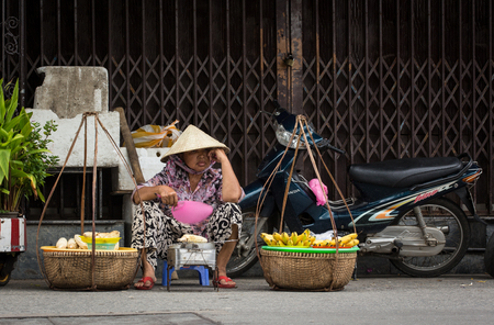 Hoi An, Vietnam - Dec 1, 2015. A vendor on street in Hoi An Ancient Town, Vietnam. Hoi An is Vietnam most atmospheric and delightful town.