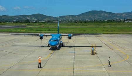 Dalat, Vietnam - Oct 30, 2015. An ATR 72 airplane of Vietnam Airlines docking at Lien Khuong Airport (DLI) in Dalat, Vietnam. Sajtókép