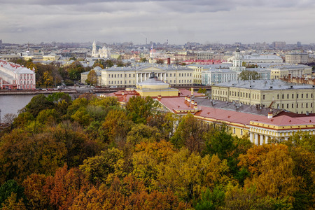 Autumn park with many old buildings in Saint Petersburg, Russia. St. Petersburg was the imperial capital for 2 centuries, having been founded in 1703.