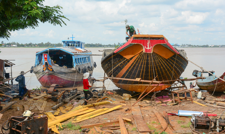 An Giang, Vietnam - Oct 2, 2015. Wooden cargo boats building at shipyard in An Giang, Vietnam. An Giang located along the the upper branches of the Mekong River.
