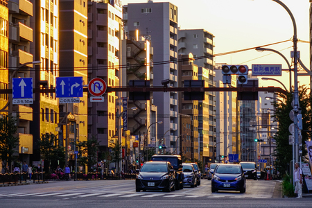 Tokyo, Japan - May 20, 2017. Street at sunset in Tokyo, Japan. The Greater Tokyo Area is the most populous metropolitan area in the world.