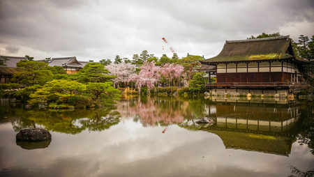 Kyoto, Japan - Apr 6, 2014. Ancient wooden palace with cherry blossom at Heian Jingu Shrine in Kyoto, Japan. Editorial