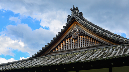 Top of ancient Buddhist temple in Kyoto, Japan. Sajtókép
