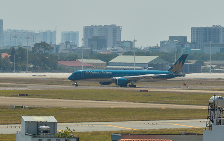Saigon, Vietnam - Feb 25, 2019. An A350-900 airplane of Vietnam Airlines taxiing on runway at Tan Son Nhat Airport (SGN).