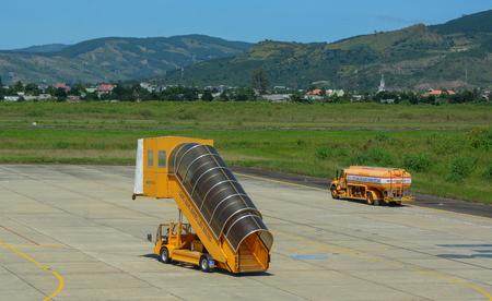 Dalat, Vietnam - Oct 30, 2015. Gangway on airfield of Lien Khuong Airport (DLI) in Dalat, Vietnam. Sajtókép