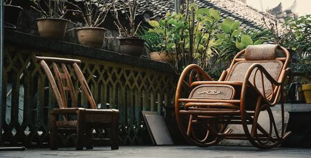 Chinese-style wooden chairs at rural house in Fenghuang Old Village, China.