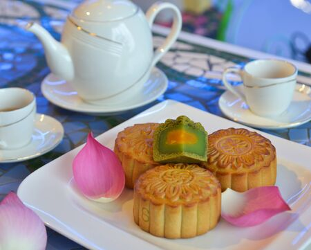 Tasty moon cake for Mid-Autumn festival with tea pot.