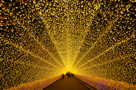 Nagoya, Japan - Mar 16, 2018. Giant led light tunnel in Nabana No Sato Park. Many tourists sightseeing walking and taking a picture in the tunnel.